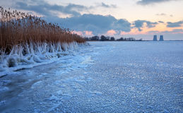 Beautiful winter landscape with frozen reservoir and power plant Stock Photo