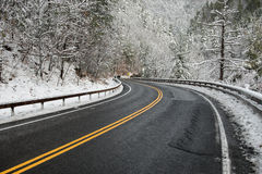 Beautiful winter landscape with highway road with turn and snow-covered trees. Stock Photos