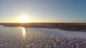 Beautiful winter landscape of icy lake. 4K aerial view of the distance from the lake shore. winter landscape stock video
