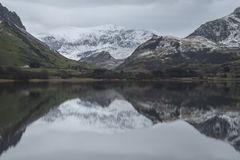 Beautiful Winter landscape image of Llyn Nantlle in Snowdonia Na Stock Image