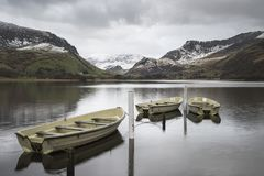 Beautiful Winter landscape image of Llyn Nantlle in Snowdonia Na Stock Images