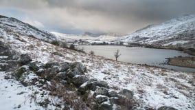 Beautiful Winter landscape image of Llynnau Mymbyr in Snowdonia Royalty Free Stock Photo