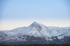 Beautiful Winter sunrise landscape image of Mount Snowdon and ot Royalty Free Stock Photo