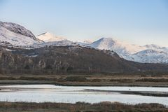 Beautiful Winter sunrise landscape image of Mount Snowdon and ot Stock Images