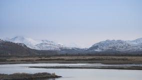 Beautiful Winter sunrise landscape image of Mount Snowdon and ot Royalty Free Stock Photo