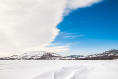 Beautiful winter landscape. With a lake and a blue sky Stock Images