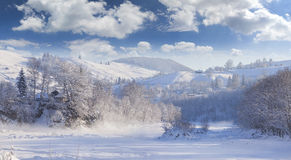 Beautiful winter landscape in the mountain village. Royalty Free Stock Photo