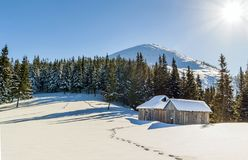 Beautiful winter landscape in the mountains with snow path in st. Eppe and small little houses. Happy New Year celebration concept Stock Photos