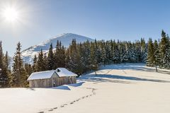 Beautiful winter landscape in the mountains with snow path in st. Eppeand small little houses. Happy New Year celebration concept Stock Image