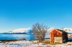 Northern Norway. Beautiful winter landscape of Northern Norway with wooden huts overlooking breathtaking fjords scenery Royalty Free Stock Photography