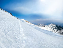 Beautiful winter landscape of pathway in slope in the mountains Royalty Free Stock Image