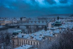 winter landscape of Prague city and Vltava river in Czech Republic, night view royalty free stock image