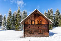 Beautiful Winter landscape with a small chalet Royalty Free Stock Images
