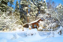 Beautiful winter landscape with snow-covered trees and house royalty free stock photos
