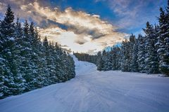 Beautiful winter landscape with snow, forest and clouds. In Karakol, Kyrgyzstan stock images