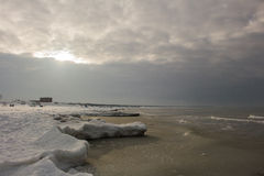 Beautiful winter landscape with snowy breakwater and ice, Baltic Sea Royalty Free Stock Photo