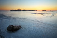 Beautiful winter landscape with stump in the ice Stock Photos