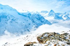 Beautiful winter landscape of winter sunny day of Dombaj mountains with sky, clouds, Russia stock images