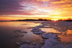 Beautiful winter landscape with sunset sky and frozen lake Royalty Free Stock Images