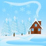 Beautiful  winter landscape with a wooden house and snow-bound t Royalty Free Stock Image