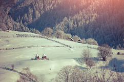 Beautiful winter morning in mountain village. Retro style Stock Photo