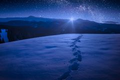 Beautiful winter night in a carpathian mountain valley with many royalty free stock photos