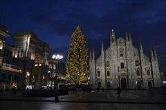 Beautiful winter panoramic view to the Duomo of Milan and Christmas tree in early morning hours. stock photography