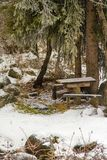 Beautiful winter with a  picnic table and benches in the snow in Kazakhstan. Almaty Stock Photography