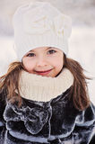 Beautiful winter portrait of adorable smiling child girl in forest Royalty Free Stock Image