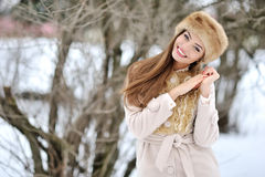 Beautiful winter portrait of young smiling woman outdoor Royalty Free Stock Photos