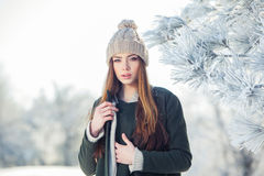 Beautiful winter portrait of young woman in the Stock Image