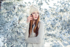 Beautiful winter portrait of young woman in the. Winter snowy scenery Royalty Free Stock Photo