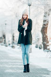 Beautiful winter portrait of young woman in the. Winter snowy scenery Royalty Free Stock Image