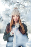 Beautiful winter portrait of young woman in the Stock Photo