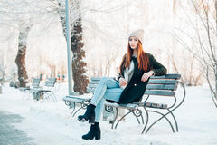 Beautiful winter portrait of young woman in the Royalty Free Stock Images