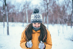 Beautiful winter portrait of young woman. In the winter snowy scenery Royalty Free Stock Photo
