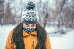 Beautiful winter portrait of young woman. In the winter snowy scenery Royalty Free Stock Photos