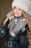 Beautiful winter portrait of young woman in the winter Stock Photography