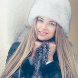 Beautiful winter portrait of young woman in the winter Stock Images