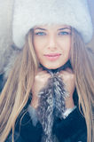 Beautiful winter portrait of young woman in the winter. Close up Stock Photos