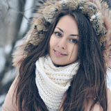 Beautiful winter portrait of young woman in the winter snowy sce Stock Photos