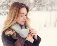 Beautiful winter portrait of young woman in the winter snowy scenery Royalty Free Stock Image