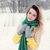 Beautiful winter portrait of young woman in the winter snowy scenery Royalty Free Stock Photography