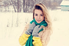 Beautiful winter portrait of young woman in the winter snowy scenery Stock Photos