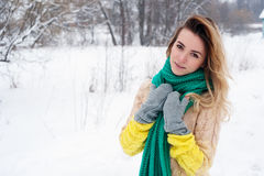 Beautiful winter portrait of young woman in the winter snowy scenery Royalty Free Stock Images