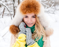 Beautiful winter portrait of young woman in the winter snowy scenery Stock Image