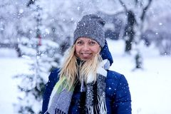 Beautiful winter portrait of young woman in the winter snowy scenery. Beautiful girl in winter clothes. Royalty Free Stock Photo