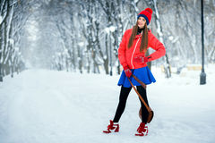Beautiful winter portrait of young woman in the winter snowy scenery. Royalty Free Stock Photo
