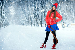 Beautiful winter portrait of young woman in the winter snowy scenery. Royalty Free Stock Photos