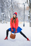 Beautiful winter portrait of young woman in the winter snowy scenery. Stock Photos
